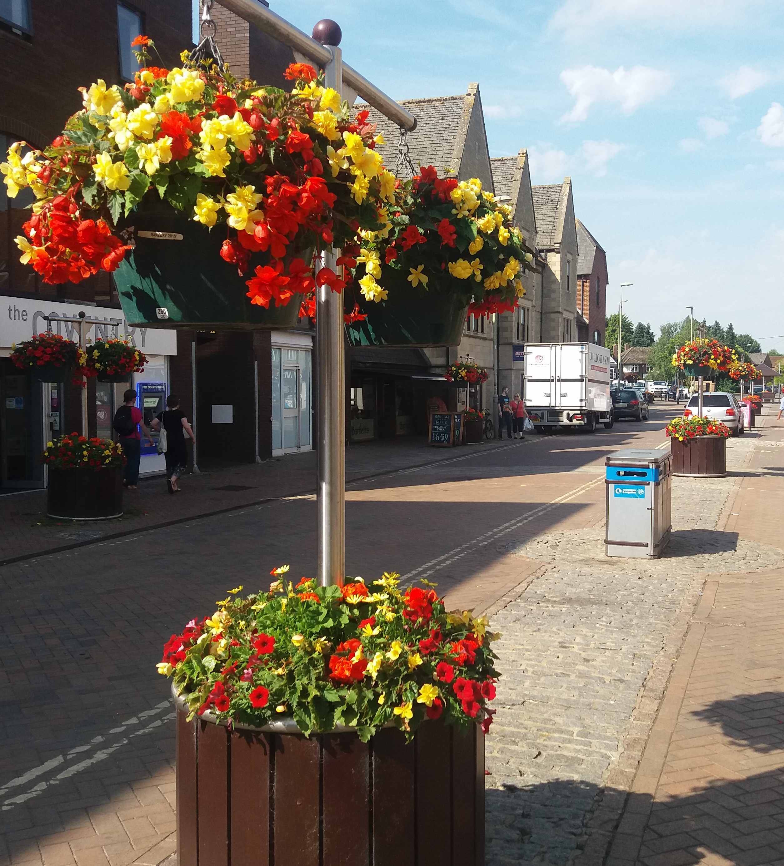 high street with yellow and red flowers